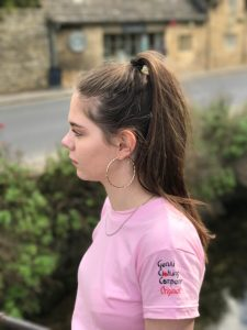 Girl wearing pink t-shirt with logo on the sleeve
