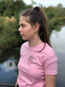 Girl wearing pink t-shirt with logo on the chest