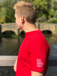 Teenage boy wearing red t-shirt with logo on the sleeve