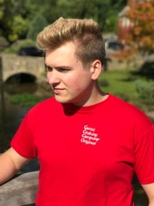 Teenage boy wearing red t-shirt with logo on the chest