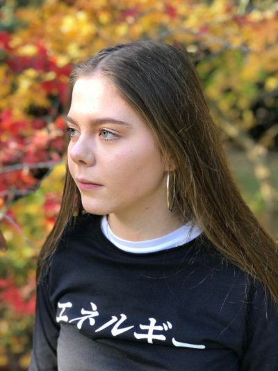 Woman wearing a black t-shirt with the word Genki on the front