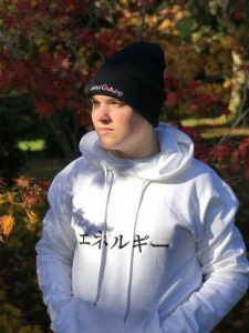 Man wearing white hoodie with Japanese word for Energy and a black beanie