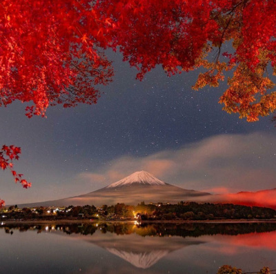 View of Japanese mountain and lake framed by red maples