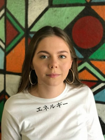 Teenage girl wearing a white t-shirt with the word Energy in katakana at the top