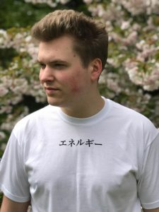 Teenage boy wearing a white t-shirt with the word Energy in katakana at the top