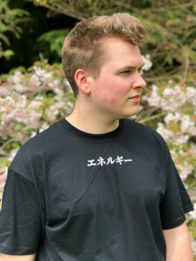 Teenage boy wearing a black t-shirt with the word Energy in katakana at the top