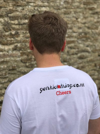 The back of a teenage boy wearing a white t-shirt featuring the word Cheers