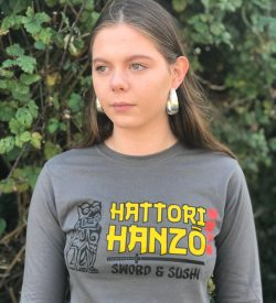 Teenage girl wearing grey t-shirt with a Hattori Hanzo design