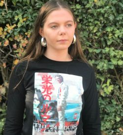 Teenage girl wearing a black t-shirt with a Steve McQueen design